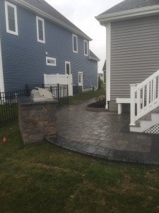 STI Patio and Walkwaybetween blue house and gray house