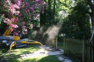 fence and landscaping remodel with bulldozer machine