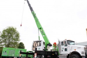 White truck with green crane at sussex crane